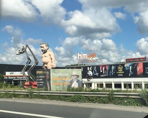 Nude man on side of road in Belgium