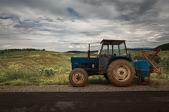 Old Tractor Parked Besides The Road