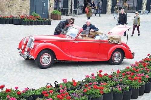 Admiring a red car
