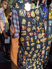 "Pin collector with ""My First Visit"" badge 1, entry queue, Disneyland, Anaheim, California, USA"
