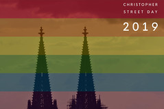 Two church towers behind rainbow colours and picture title Christopher Street Day 2019