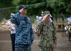 Navy Capt. Matthew Lehman and Ukrainian navy Rear Adm. Alexey Neizhpapa participating nation's flags during the closing ceremony.