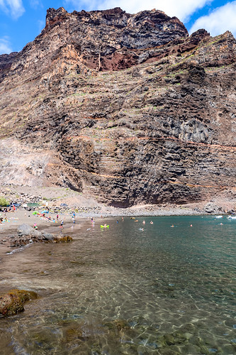 Steep rock at Playa De Vueltas black sand beach on La Gomera, Spain