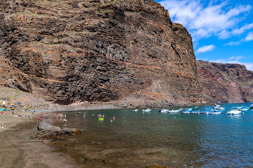 View of the steep coast at Playa De Vueltas black sand beach on La Gomera, Spain