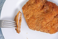 Flat lay above served Breaded Meat on the plate