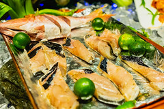 Raw milkfish on tray with calamansi