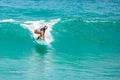 Girl in a bikini on a surf on a high wave. Nai Harn Beach, Phuket, Thailand                  XOKA5751bs