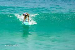 Girl in a bikini on a surf on a high wave. Nai Harn Beach, Phuket, Thailand              XOKA5749bs