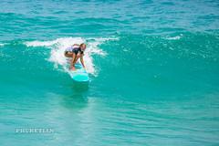 Girl in a bikini on a surf on a high wave. Nai Harn Beach, Phuket, Thailand                XOKA5750bs
