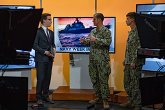 Sailors participate in a television interview during Duluth Navy Week, July 16, 2019.