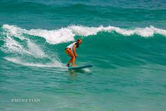 Girl in a bikini on a surf on a high wave. Nai Harn Beach, Phuket, Thailand                 XOKA5752bs