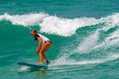 Girl in a bikini on a surf on a high wave. Nai Harn Beach, Phuket, Thailand                XOKA5752b3s