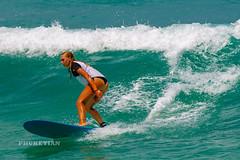 Girl in a bikini on a surf on a high wave. Nai Harn Beach, Phuket, Thailand                   XOKA5753b3s
