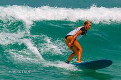 Girl in a bikini on a surf on a high wave. Nai Harn Beach, Phuket, Thailand                  XOKA5753b4s