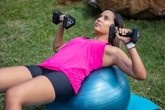 Girl exercising doing stability ball dumbbell chest press