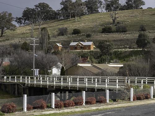 View from Carcoar's main street across Belubula River Bridge to old railway station.