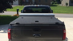 A Custom Heavy Duty Truck Bed Cover On A Ford Super Duty