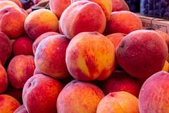 Ripe red-orange peaches background