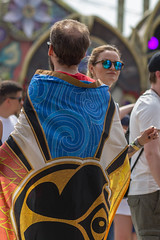 Man covered in a big cloth with the Tomorrowland logo on it