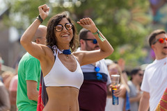 Woman in sunglasses dancing at the first day of Tomorrowland