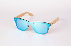 Wooden sunglasses on white background
