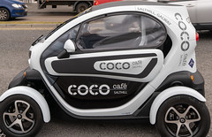 A RENAULT TWIZY USED AS AN ADVERTISING PLATFORM [FOR THE COCO CAFE IN SALTHILL]-154329