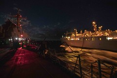 USS McCampbell conducts a replenishment-at-sea with USNS Richard E. Byrd (T-AKE 4) at night.