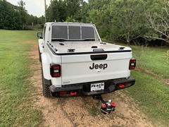 A Heavy Duty Truck Bed Cover On A Jeep Gladiator
