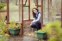 Woman tending to her greenhouse veg