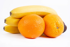 Oranges and Bananas isolated above white background