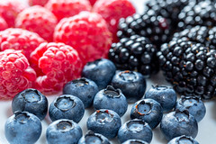 Ripe blueberry, raspberry and mulberry fruits