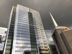 Glass office building and steeple of Arlington Temple against the sky, Nash Street, Arlington, Virginia