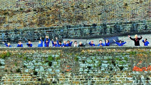 School Children Waving at Departing Cruise Ship