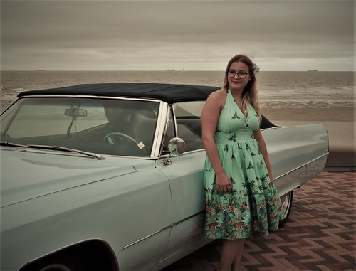 50's girl with her Cadillac