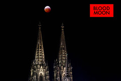 Blood Moon: Shadow eclipse with full red moon over German Cathedral in Cologne