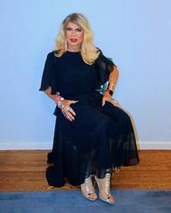 Cortney - Blonde in black taffeta dress and silver heels (sitting)