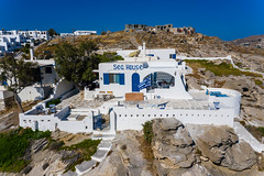 Sea House Hotel near the beach, made of white limestone, on the rocky island Paros in Greek