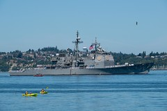 USS Mobile Bay participate in a parade of ships during the 70th annual Seattle Fleet Week.