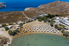 Aerial view of the Monastiri beach, with sunbeds and parasols on Paros, Greece