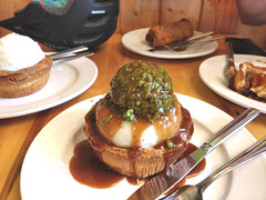 Aussie pie with mashed potato, mushy peas and gravy