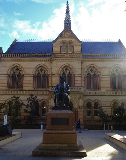Photo:Adelaide. The Mitchell building built 1881 at the University of Adelaide. In front is the statue of Sir Walter Watson Hughes of Moonta Mines who donated 20,000 pounds to start the university in 1872. By denisbin