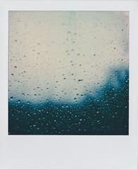 Polaroid of raindrops on a window