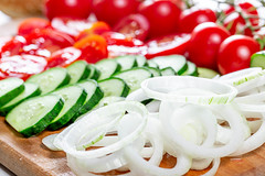 Rings of sliced onions, tomato and cucumber circles close-up