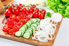 Sliced fresh ripe vegetables for making burgers