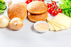 Kitchen table with ingredients for cooking burgers