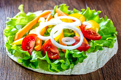 Chopped vegetables and lettuce on pita