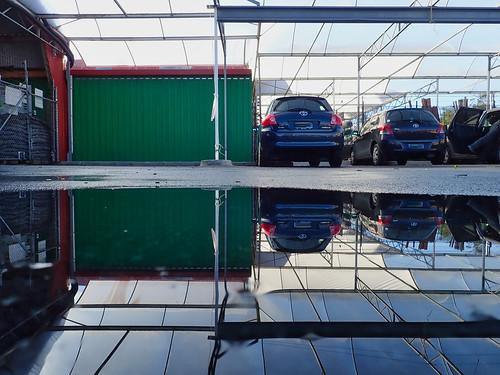 Kings carpark cars reflections and leg