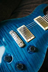 Body of an electric guitar. Details of PRS custom blue matteo