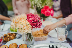 White And Red Peonies On Picnic Table