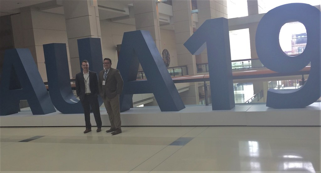 Standing in Front of AUA sign